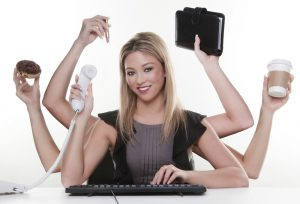 woman with six arms multitasking her work and daily life